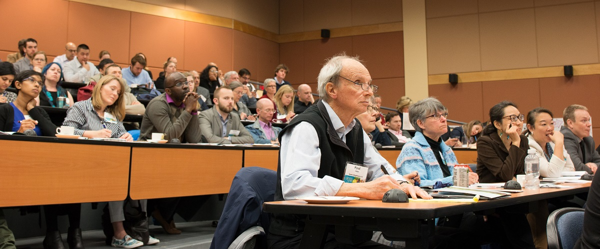 Audience members listen to a presentation at the 2016 OCC climate change symposium
