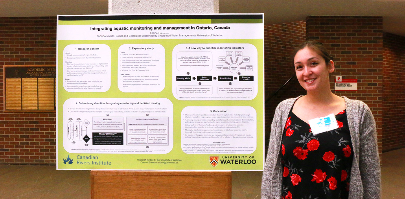 female student poses with research poster at 2017 Ontario Climate Symposium